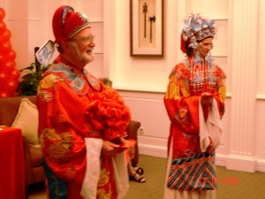 photo of couple in traditional Chinese wedding clothes (c) Katy Manck